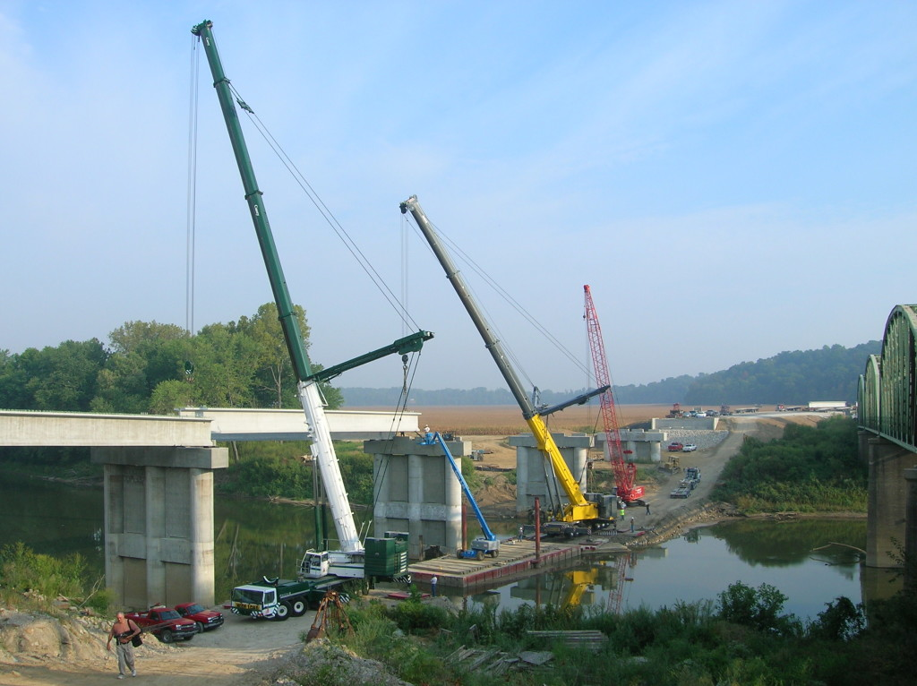 Three Sterett cranes being used to build a bridge