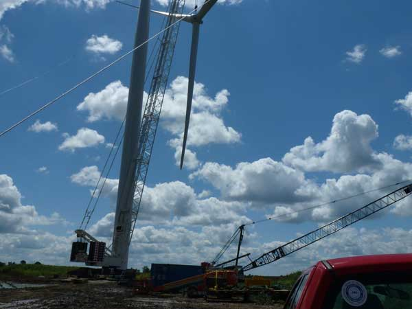 Sterett equipment being used to assemble a windmill